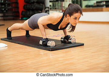 Young woman focused on her workout - Portrait of a beautiful...