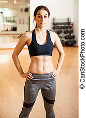 Beautiful woman with abs in a gym - Portrait of a pretty and...