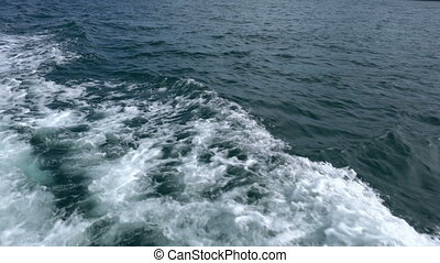 Cruise. View on waves of sea from speedboat, close-up