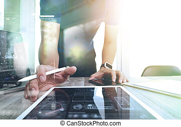 Website designer working digital tablet and smartphone and digital design diagram on wooden desk as concept