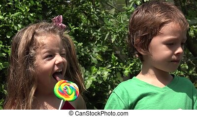 Boy And Girl Eating Candy