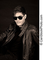 Cool retro guy - Cool young man in black leather jacket and...