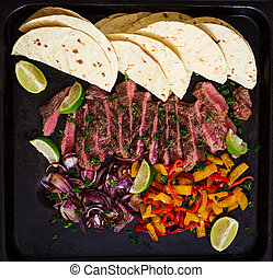 Mexican fajitas for beef steak and grilled vegetables Top...