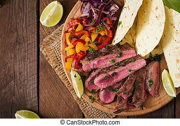 Mexican fajitas for beef steak and grilled vegetables. Top...