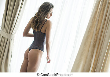 Young woman by the window