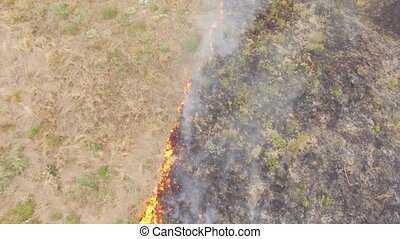Agricultural Field In Fire - AERAIL VIEW Shot directly above...
