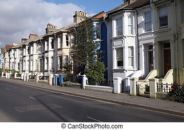 victorian terraces in england. street with english houses or...