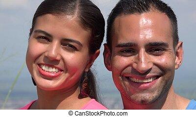 Smiling Young Hispanic Couple