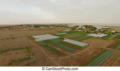 Greenhouses On Agricultural Fields - AERIAL VIEW Camera is...