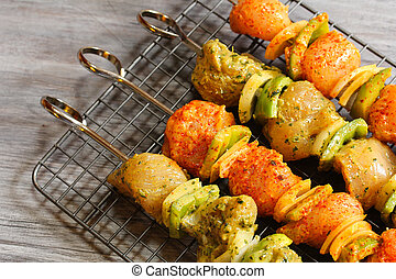 Chicken Ticka Kebab on skewers ready for grilling