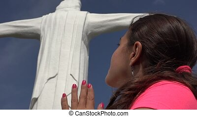 Young Religious Woman Praying