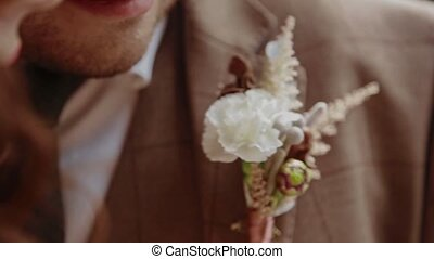Close-up groom accessory slowmotion - Close-up groom...