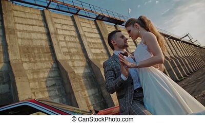 Newlyweds on the background of a dam slowmotion