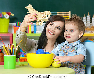 little boy playing  with mother