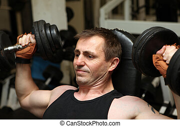 training dumbells gym pecks - training dumbbells in gym Male...