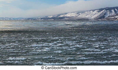 Surface of winter Baikal, water and ice in it - Surface of...