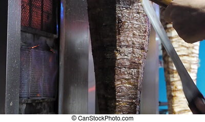 Donner kebab. Pressed meat roasted on a large vertical spit.