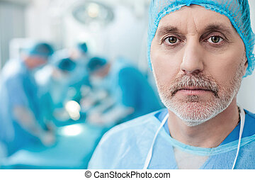 Skillful doctors are working in operating theatre -...