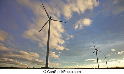 Sunset view at wind turbines under evening sun - Wind...