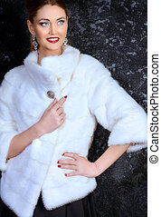 woman in mink jacket - Beautiful young woman wearing mink...
