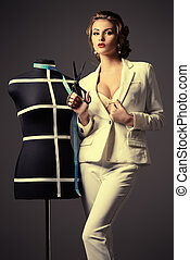 dressmaker - Portrait of a stylish woman fashion designer...