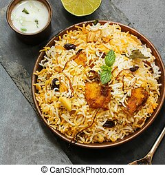 Fish Biryani made with basmati rice Famous Indian and middle...