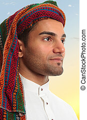 Arab man looks out expectantly - An arab middle eastern man...