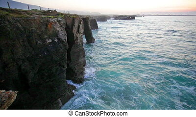 Ocean waves rolling on rocks, Ribadeo - Ocean waves rolling...