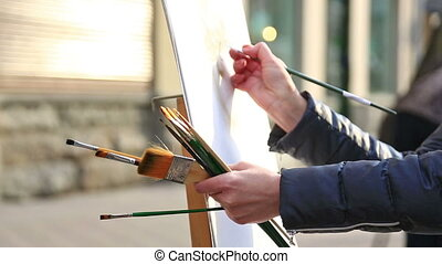 Close up view of artist painting process - Street artist...