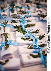 white napkins with blue ribbons