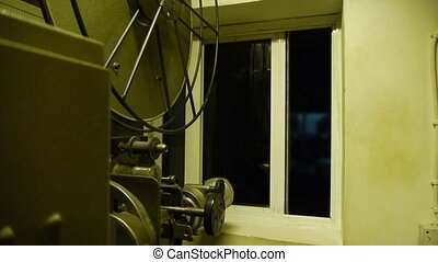 Film projector - 35 mm film projector reflected to screen in...