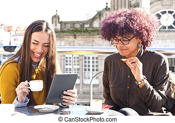 girls having coffee with the tablet