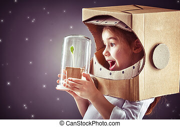 girl plays astronaut - Child is dressed in an astronaut...