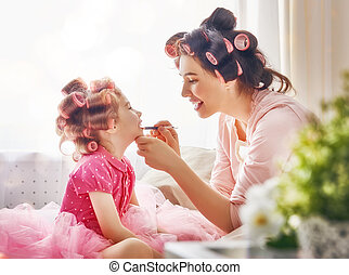 Happy loving family Mother and daughter are doing hair and...