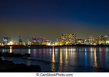 Night view of Rainbow Bridge with reflection in Tokyo Bay