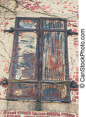 Old Shutters in Decay - Metal shutters, in a state of decay,...