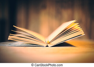 Book on wooden desktop