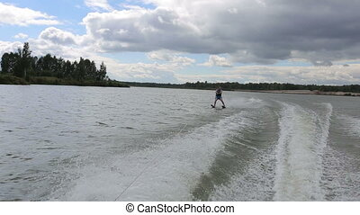 man on water ski in cloudy day on the lake