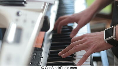man play on electric piano before concert