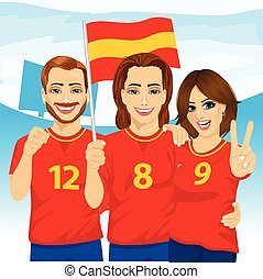 Three excited Spanish soccer fans in stadium