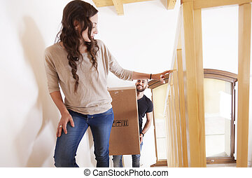 young couple furnishes the new apartment after moving