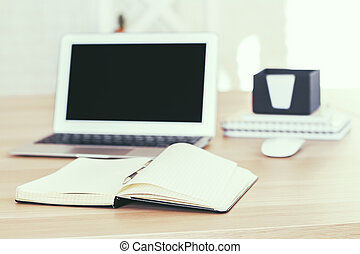 Blank screen and copybook - Desktop with blank blurry laptop...