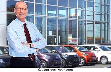 Mature Car dealer man. - Car dealer man. Auto dealership and...