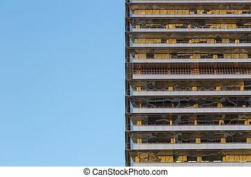 Facade of a multi story building - Modern facade of a multi...