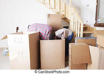young couple opened the boxes for the new house