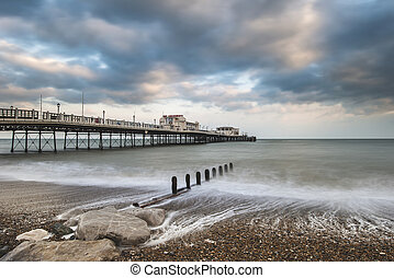Beautiful long exposure sunset landscape image of pier at...