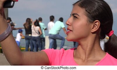 Female Tourist Taking Selfie
