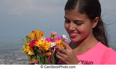 Female Teen Or Young Woman With Flowers