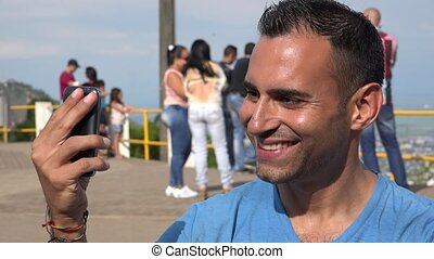 Male Tourist Smiling For Selfie