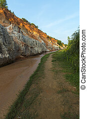 Landscape with river between red rocks and jungle Ham Tien...